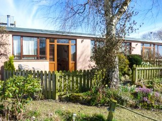 WOODPECKER, pet friendly, country holiday cottage, with a garden in High Head Castle Farm, Ref 4561
