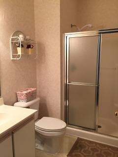 Walk in oversize  shower with sliding doors