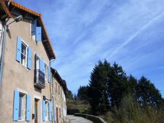 Traditional stone house with blue shutters in the Monts d'Ardeche.