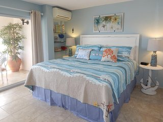 Master Bedroom with Patio Access and Ocean View!