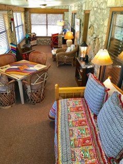 Upstairs Sunroom with AC/Heat. Two twin trundles. Sleeps 4.
