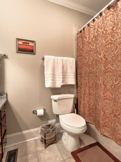 This bathroom features a shower/tub for guests to use throughout their stay.