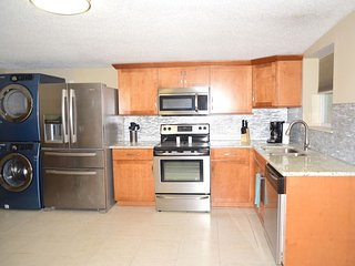 Brand new fully stocked custom kitchen with stainless steel appliances and laundry.