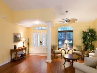 Grand front entry and sitting area.