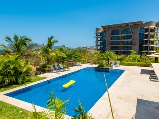 Enjoy your sixth floor ocean view condo overlooking the hills of Tamarindo