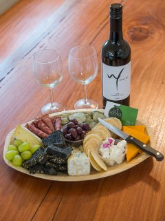 On request we provide a Cheese Platter (serves 4) without the wine displayed in the image.