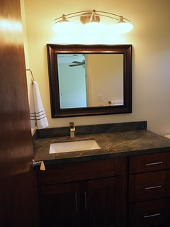 Private bathroom with granite and stone, all new fixtures.