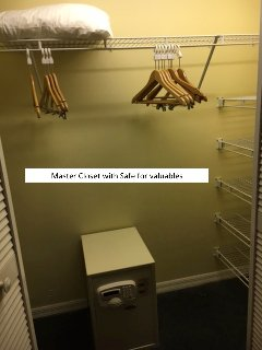 Large master closet for clothes and safe for valuables.