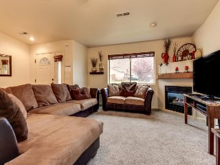 Dog-friendly townhome w/private hot tub, park access, & seasonal shared pool!
