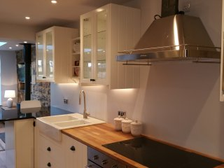 New stylish kitchen, with breakfast bar, wine fridge, double ovens, induction hob, micro, F/F