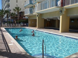 Pet friendly, walk to the beach townhome, oceanfront pool and lazy river!