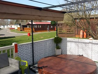 RELAX IN OUR LOVELY HOTTUB ALL YEAR ROUND WITH THE ALL WEATHER SLIDING CANOPY