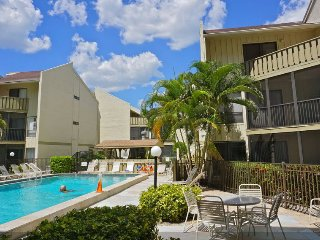 Siesta Beach Condo with a Balcony Pool View.  #1 US Beach is across the street!
