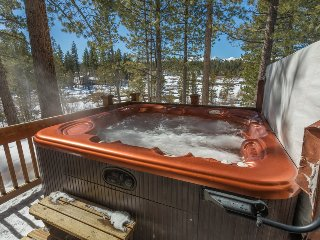 The relaxing 5 person hot tub has great views of the meadow and mountains in the background.  Perfect for unwinding after a day on the slopes or at the beach