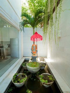 Calm and fresh, each day the villa staff make offerings to the gods at the many temples here.