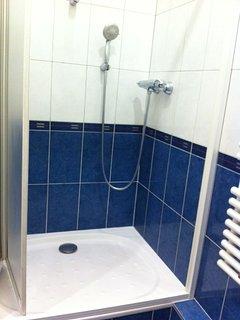 Douche - paume de douche avec 2 hauteurs possibles - réglage de la température de l'eau