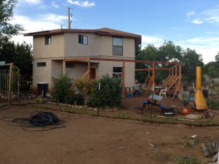 2 story hexagon house with one bedroom set on 3 acres.