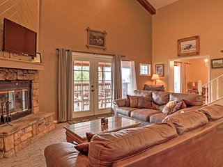Unwind in the living room with flat screen TV and gas fireplace.