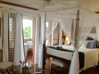 Direct views from your four poster bed straight to sea and the island!