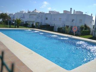 Duplex de tres habitaciones con piscina