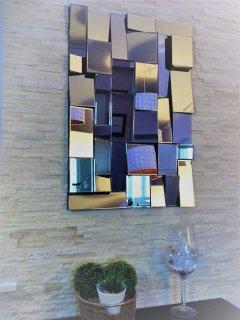 split face tiles and mirror design feature.