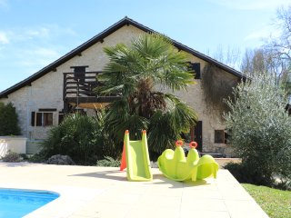 Large, heated pool with steps for easy access. Retractable pool cover to swim in all weathers