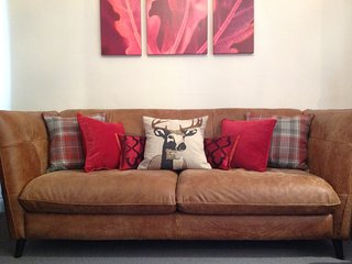 Italian leather sofa for four - settle down in comfort with a bottle of wine to watch a good film!