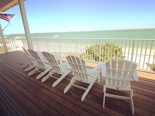 Wrap- around decks offer a perfect place to relax and watch local dolphins at play.