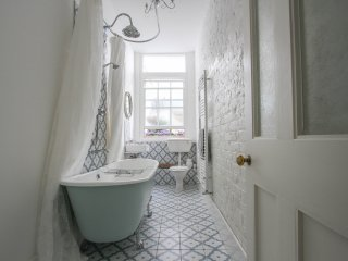 cast iron roll top bath for long, warm soaks and an over the bath shower