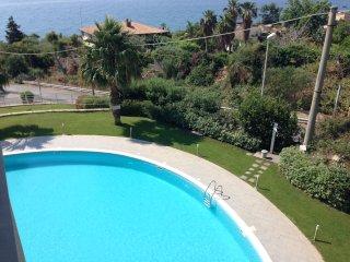 Thea - Appartamento al mare con piscina e posto auto