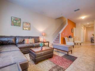 Your Disney Story starts here in this stunning town home minutes from Disney!