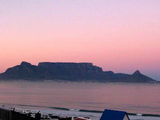 See Table Mtn & Robben island. Close to the sea, with own garden & entrance.