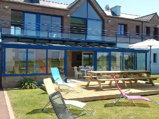 Villa with superb sea views and gate onto the beach at the end of the garden