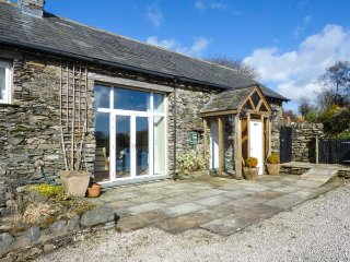 PHEASANT COTTAGE, feature beams, private patio area, walks from the door