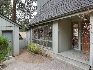 A delightful two bedroom home located in a wooded spot, yet so close to town!