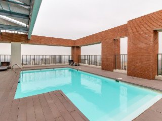 Modern, centrally located apartment w/ shared pool, gym, private balcony & more!