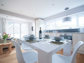 Modern dining with Eames style chairs and plenty of light
