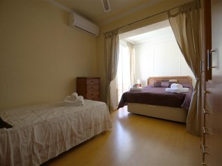 Fifth bedroom has one double and one single bed with curtains for privacy