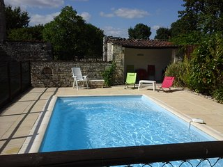 old farmhouse with private swimming pool in large enclosed grounds .