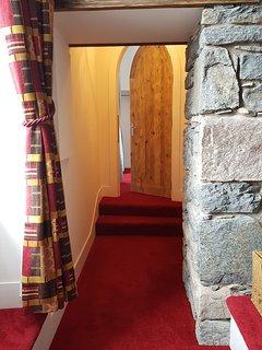 Looking through hallway to bedroom.