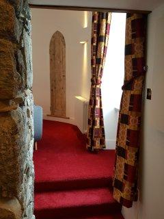 Hallway under granite stone arch.