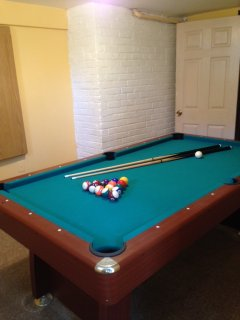 Pool table in basement.