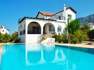 Villa Elegance sleeps 8 people with 4 bedrooms and 3 bathrooms