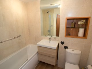 The family bathroom features a shower, bath and hand-basin