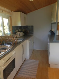 Fully equipped kitchen for everyday cooking. Oven, hob, microwave, washing machine & dishwasher.