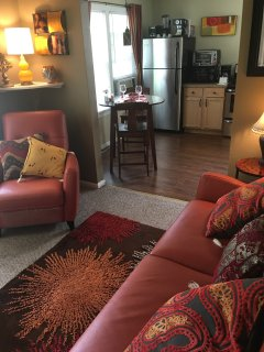 Comfy leather recliner and new stainless appliances.