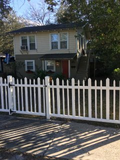 Charming picket fence greets you.
