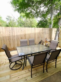 newly built deck with patio seating for 7