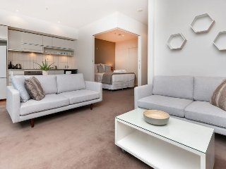 One Bedroom Apartment in Viaduct Harbour with Balcony. Carpark Included