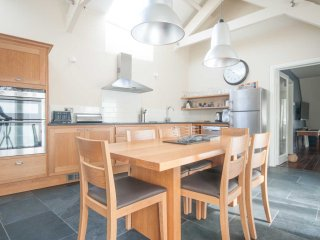 Great kitchen space with vaulted ceiling and log burner